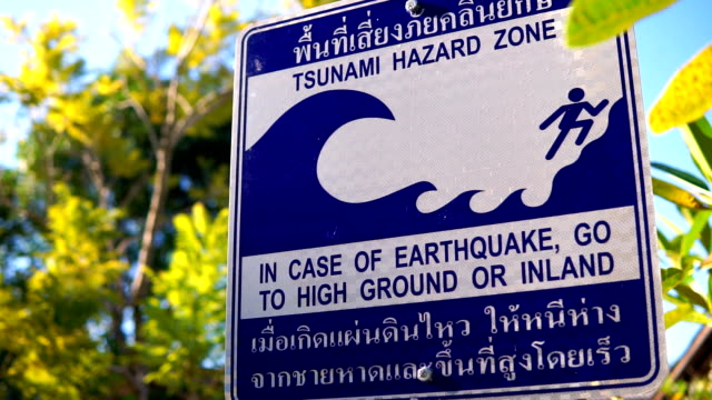 tsunami hazard zone earthquake evacuation warning sign - tsunami stock videos & royalty-free footage