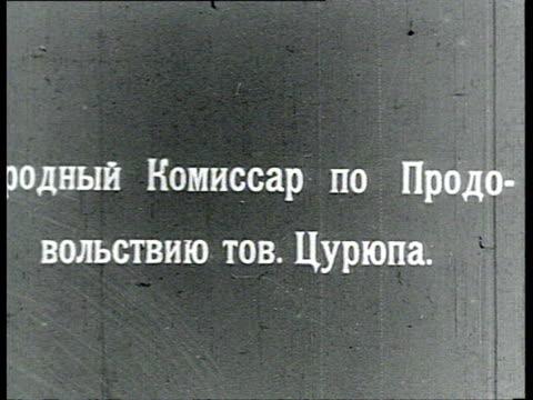 vidéos et rushes de tsuriupa popular commissar for food supply smokes cigarette / russia - 1918