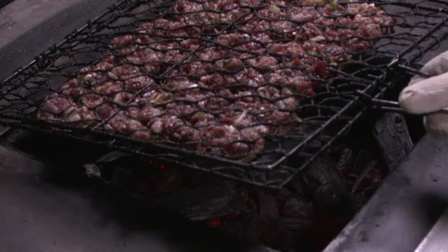 tteok-galbi(grilled short rib patties) on the burning charcoal - roast beef stock videos & royalty-free footage