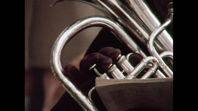 cu tuba played in a brass band, 1970s - ブラスバンド点の映像素材/bロール
