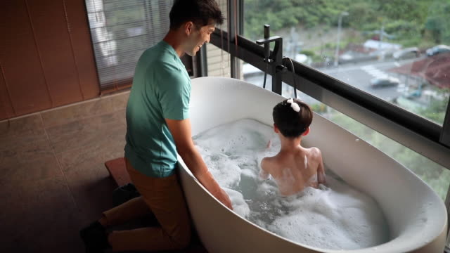 tubby time is family time - bubble bath stock videos & royalty-free footage