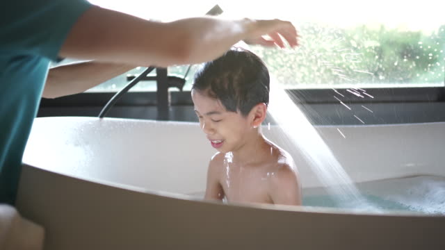 tubby time - taking a bath stock videos & royalty-free footage
