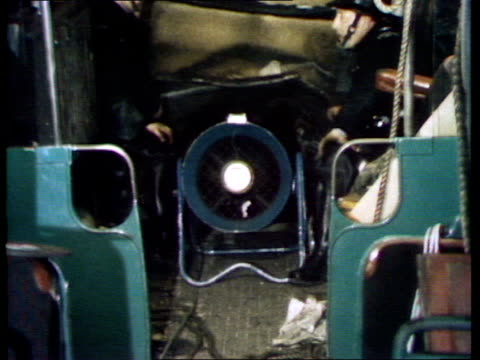 inside carriage england london moorgate station third coach roof up to ceiling ms inside third coach firemen by small fan on floor yellow tarpaulin... - train crash stock videos and b-roll footage