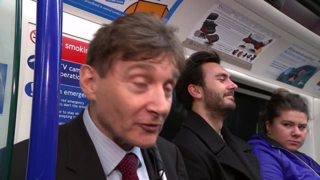 london tom pey in tube carriage accepting offer of seat from woman pey sitting tom pey interview sot int commuters along at busy tube station person... - visual impairment bildbanksvideor och videomaterial från bakom kulisserna