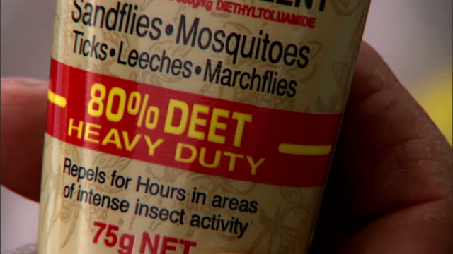 a tube of insect repellent indicates its percentage of deet in the active ingredients. - 虫除け点の映像素材/bロール