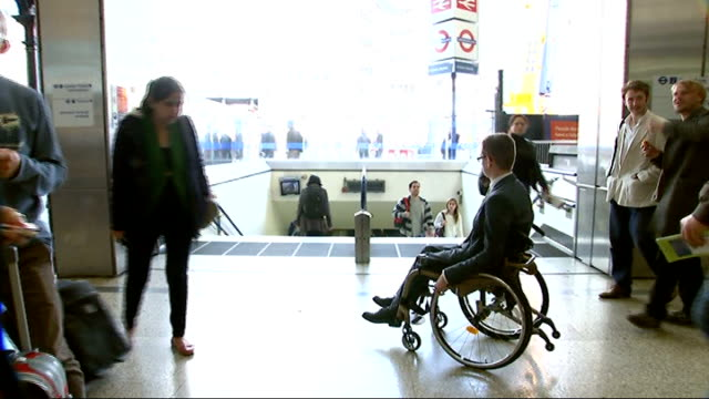 stockvideo's en b-roll-footage met tube stations to become more accessible to disabled people; england: london: ext george fielding boarding train with help of rail workers and ramp... - atlete
