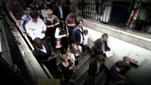 tube strikes announced over pay and conditions; file: date unknown: england: london: ext treated film various shots crowd waiting to enter closed... - building entrance stock videos & royalty-free footage