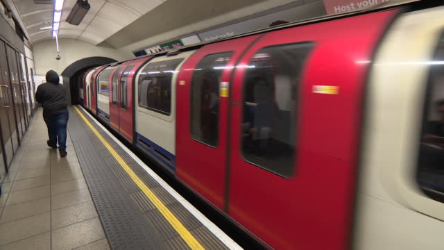 tube train pulling into and leaving platform at oxford circus underground station - public transport stock videos & royalty-free footage