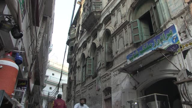 tucked away near the centuries-old storytellers' bazaar, the decaying pakistani mansions once home to bollywood superstars are being brought back to... - storyteller stock videos & royalty-free footage