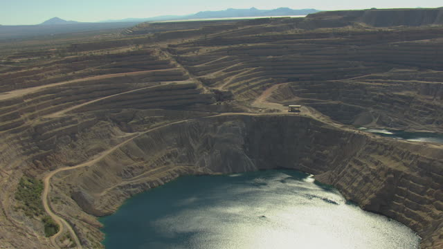 ws aerial td tucson mining district and twin buttes mine filled with water / arizona, united states  - copper mine stock videos and b-roll footage