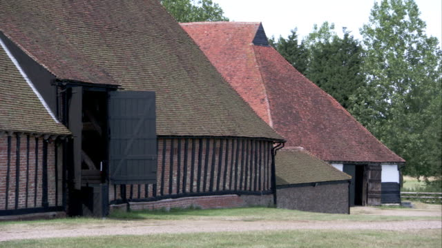tudor farmhouses and medieval barns surround the grounds of cressing temple, essex. available in hd. - essex ostengland stock-videos und b-roll-filmmaterial