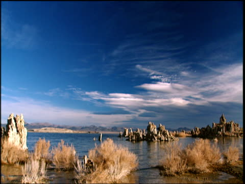 tufa (calcium carbonate towers) on lake mono under beautiful blue sky - calcium carbonate stock videos and b-roll footage