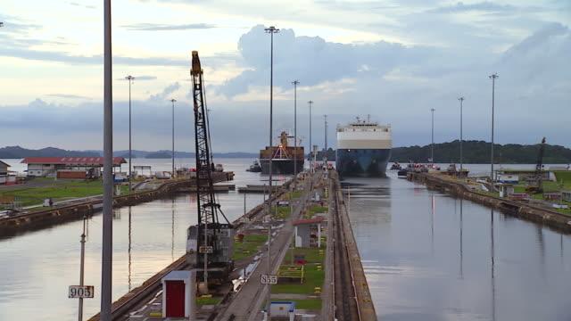 WS T/L Tug boat and ship approach dock at Panama Canal Gatun Locks  /  Panama City, Panama