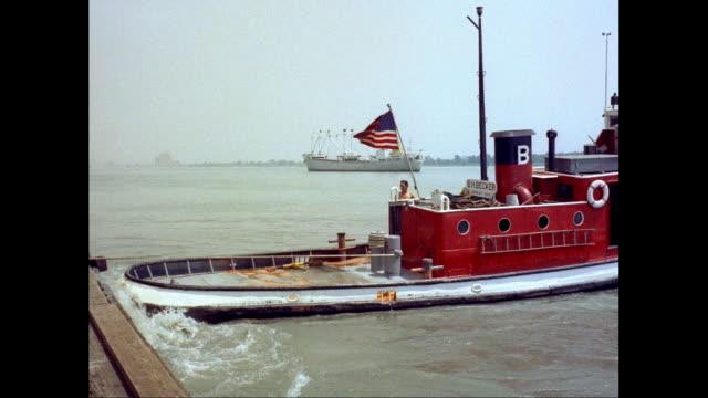 vidéos et rushes de ws ts tug boat moored near harbour / united states - clap de cinéma