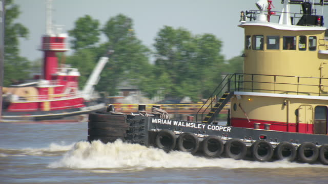 MS TS Tug boat moving in river / New Orleans, Louisiana, United States