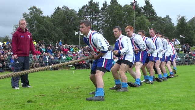 ms tug of war at braemar royal highland games / braemar, aberdeenshire, scotland - rope stock videos & royalty-free footage