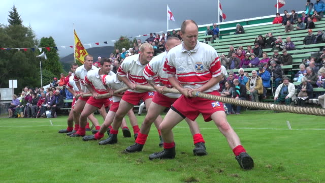 ms tug of war at braemar royal highland games / braemar, aberdeenshire, scotland - highland games stock videos & royalty-free footage