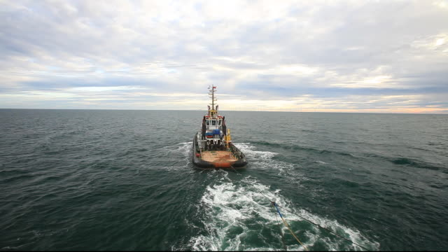a tug pulls a jack up barge to build the walney offshore wind farm off barrow in furness, cumbria, uk, when finished it will have 102, 3.6 mw turbines, giving a total capacity of the walney project of 367.2 mw, enough to power 320,000 homes. the rotor diam - pulling stock videos & royalty-free footage