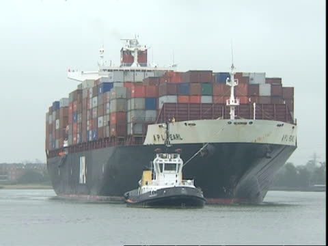 Tug towing APL Pearl Container ship, Container Terminal, Southampton, UK