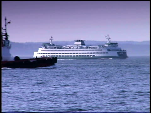 tugboat and ferry in sea - tugboat stock videos and b-roll footage