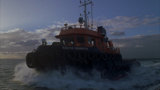 ms pov tugboat at sea at sunset - tugboat stock videos and b-roll footage