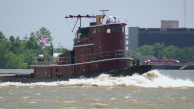 MS TS Tugboat cruising along in Mississippi river / New Orleans, Louisiana, United States
