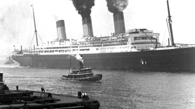 a tugboat floats alongside an ocean liner in new york harbor. - 1932 stock videos & royalty-free footage