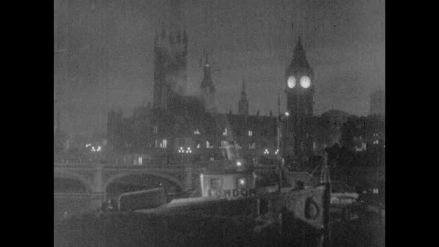 1925 tugboat passes london's big ben clock at night - fluss themse stock-videos und b-roll-filmmaterial
