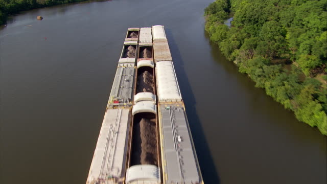 a tugboat pushes a barge on the chicago river. - barge stock videos & royalty-free footage