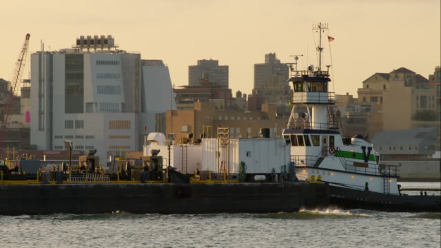 tugboat pushing a barge up the hudson river - tugboat stock videos and b-roll footage