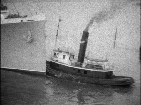 b/w 1929 tugboat pushing s.s. bermuda ocean liner away from port / home movie - tugboat stock videos and b-roll footage