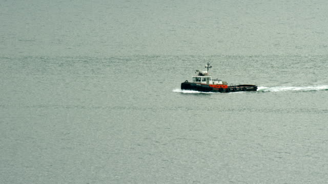 tugboat sails in alaskan waters - towing stock videos and b-roll footage