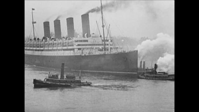 1921 tugboats push acquitania steamship in nyc harbor - passenger craft stock videos & royalty-free footage