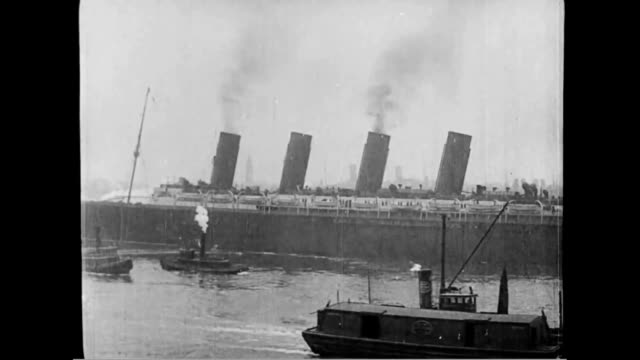 Tugs alongside Lusitania as it departs harbor