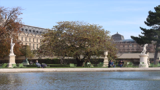 tuileries garden open, people sitting on chairs around a pond, on the second day of isolation on october 31, 2020 in paris, france. france imposed... - pelvis stock videos & royalty-free footage