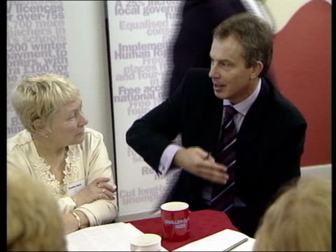 tuition fees on hold; news at ten: john ray england: leeds: int tony blair mp sitting round table with group of local people tony blair mp... - charles clarke uk politician stock videos & royalty-free footage