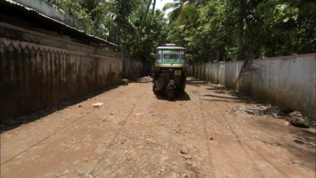 MS POV Tuk Tuk cab driving through residential area / Kochi, Kerala, India