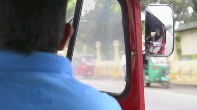 Tuk tuk driving on the streets of Kandy, Central Province, Sri Lanka, Asia