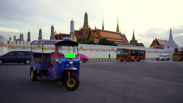 tuk tuk is parking in front of wat phra kaeo or grand palace, bangkok, thailand. - auto rickshaw stock videos & royalty-free footage