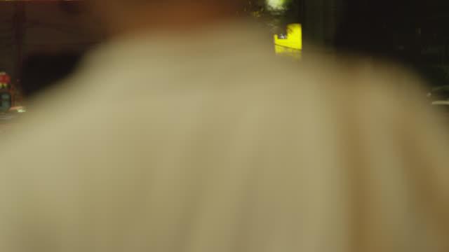 LS Tuk Tuk taxi weaving through traffic at night, RED R3D 4K