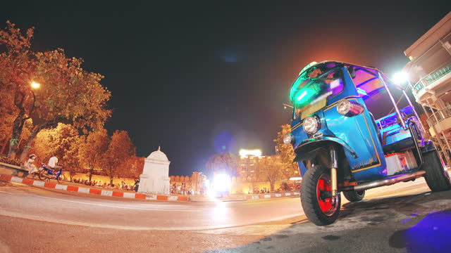 tuk tuk taxi with city traffic street night time - auto rickshaw stock videos & royalty-free footage