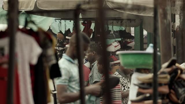 "tuk tuks and market stalls, benin city, nigeria - ""bbc universal"" stock videos & royalty-free footage"