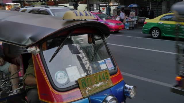 tuk-tuk on yaowarat road, chinatown, bangkok, thailand, southeast asia, asia - bangkok stock videos & royalty-free footage