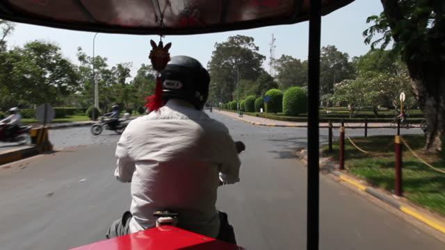 MS POV TukTukpassing through street / Siem Reap, Siem Reap, Cambodia