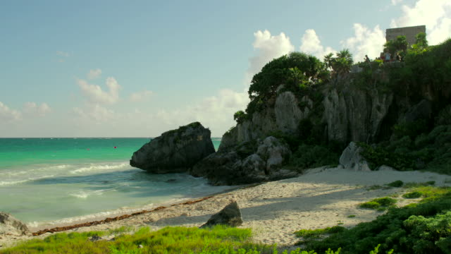 tulum beach with mayan monument on rocks, tulum, mexico - quintana roo stock videos and b-roll footage