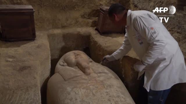 tumbas de importantes sacerdotes de unos 3000 anos de antiguedad en las que había sarcofagos en piedra y madera fueron descubiertas al sur de el... - arqueologia stock videos & royalty-free footage