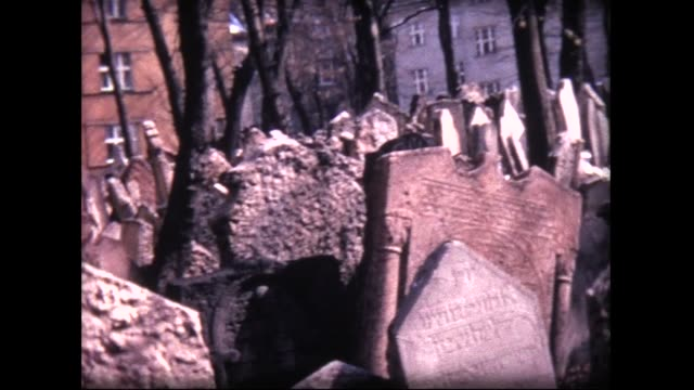 1970 tumbled down grave stones in old jewish cemetery. prague - gravestone stock videos & royalty-free footage