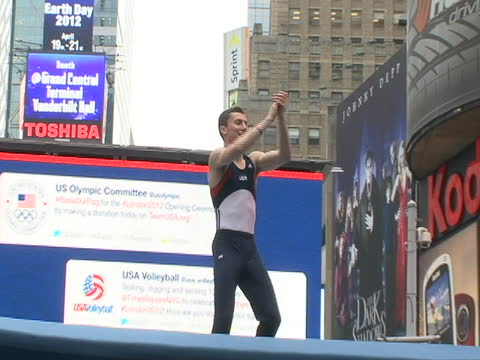 tumbling on trampoline in times square at countdown to olympics event in times square in new york city. athletes demos, good generic b-roll of... - manhattan new york city stock videos & royalty-free footage