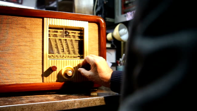 tuning a vintage radio - radio broadcasting stock videos & royalty-free footage