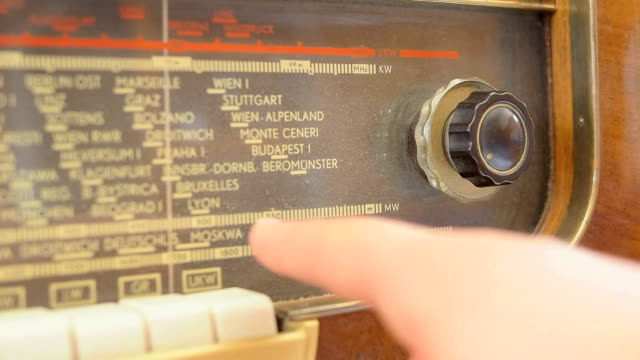 tuning an old radio - dialling stock videos & royalty-free footage